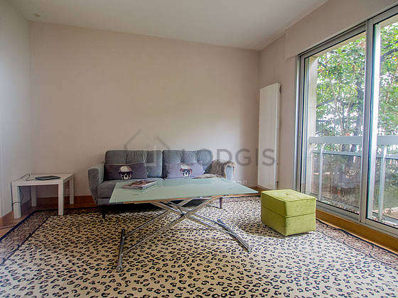 Very quiet living room furnished with sofa, coffee table, wardrobe, cupboard