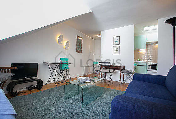 Living room furnished with 1 sofabed(s) of 90cm, tv, 1 chair(s)