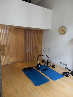 Bright bedroom equipped with air conditioning, tv