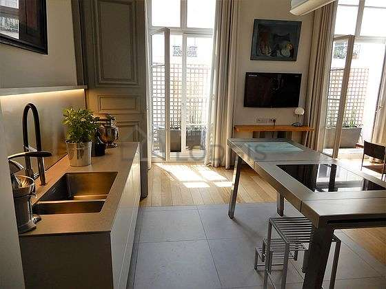 Kitchen where you can have dinner for 6 person(s) equipped with washing machine, dryer, refrigerator, crockery
