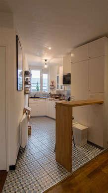 Belle cuisine de 11m² avec du carrelageau sol