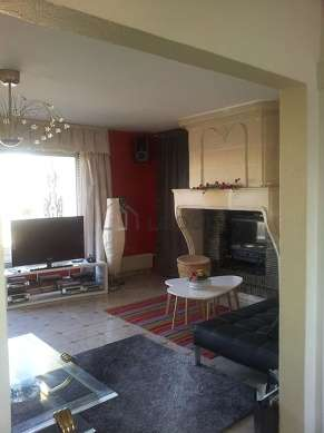 Very quiet living room furnished with tv, hi-fi stereo, fan