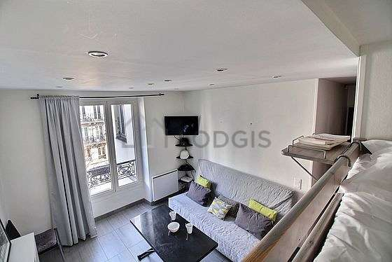 Very quiet living room furnished with 1 bed(s) of 140cm, tv, 1 chair(s)