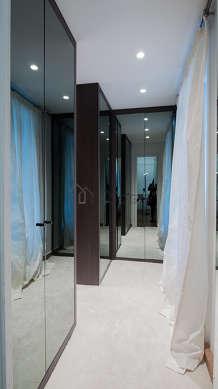 Very quiet walk-in closet with the carpetingfloor