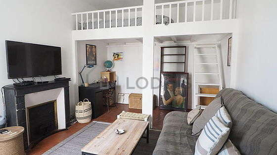 Very quiet living room furnished with 1 bed(s) of 140cm, tv, storage space, 1 chair(s)