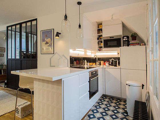 Kitchen equipped with dishwasher, hob, refrigerator, crockery