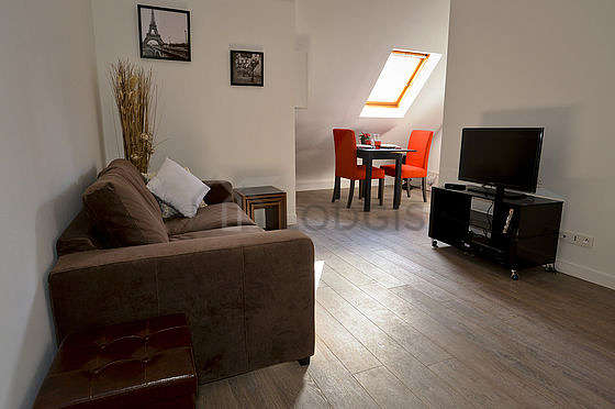 Very quiet living room furnished with tv, dvd player, 1 armchair(s), 1 chair(s)