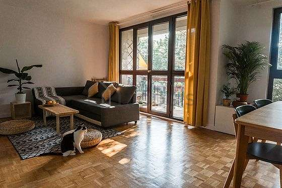 Living room with double-glazed windows and balcony