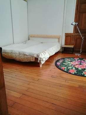 Chambre de 15m² avec du parquetau sol