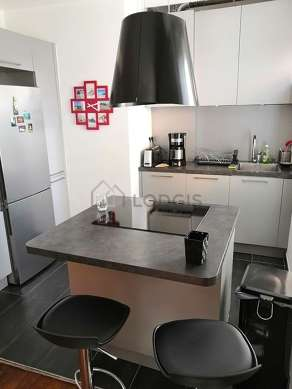 Kitchen equipped with dishwasher, hob, refrigerator