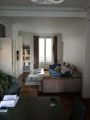Living room furnished with tv, dvd player, 1 armchair(s), 1 chair(s)