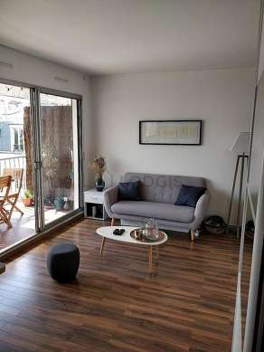 Very quiet living room furnished with 1 murphy bed(s) of 140cm, tv, fan
