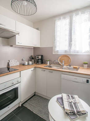Kitchen equipped with crockery