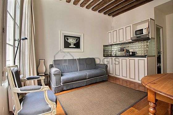 Very quiet living room furnished with tv, 1 armchair(s), 1 chair(s)