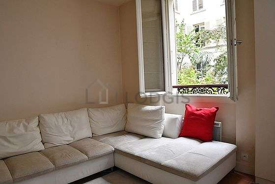 Very quiet living room furnished with sofa, closet, cupboard, 1 chair(s)
