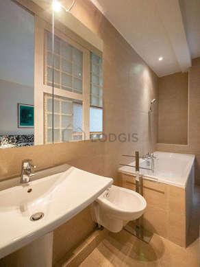 Bathroom equipped with bath tub, bidet, shower in bath tub