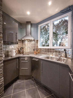Kitchen equipped with dryer, refrigerator, extractor hood, crockery