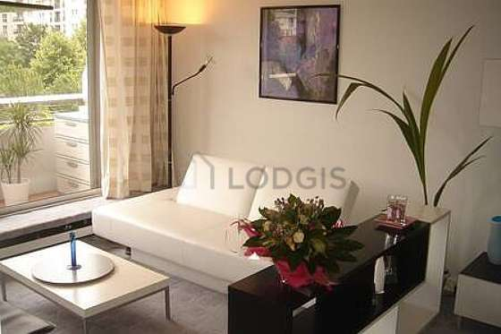 Very quiet living room furnished with sofa, coffee table, cupboard