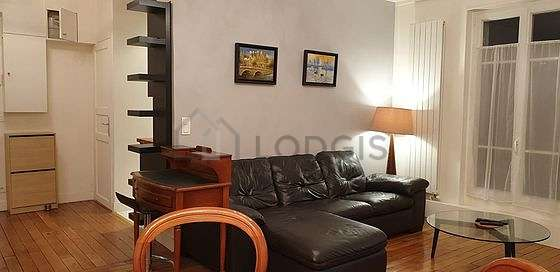 Living room furnished with tv, wardrobe, 5 chair(s)