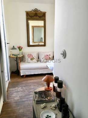 Very quiet living room furnished with 1 bed(s) of 110cm, tv, 1 armchair(s), 1 chair(s)