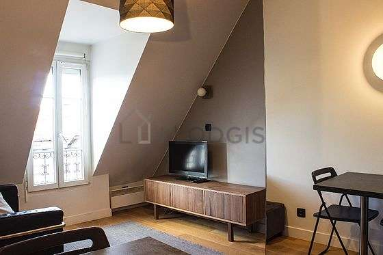 Quiet living room furnished with tv, wardrobe, cupboard, 1 chair(s)