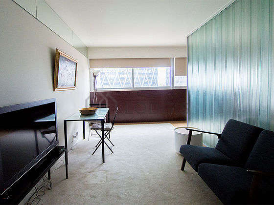 Very quiet living room furnished with 1 bed(s) of 140cm, tv, 1 armchair(s), 1 chair(s)
