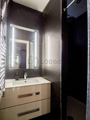Pleasant bathroom with double-glazed windows and with tilefloor