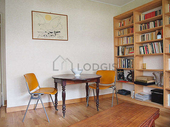 Quiet living room furnished with sofa, coffee table, cupboard, 4 chair(s)
