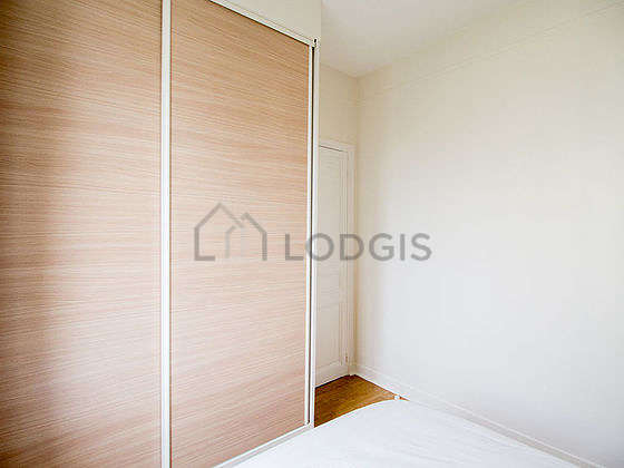 Very bright bedroom equipped with wardrobe, cupboard, bedside table