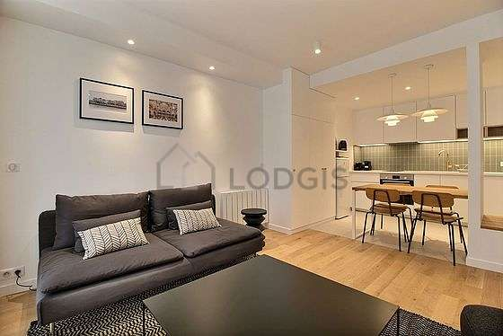 Very quiet living room furnished with sofa, 1 armchair(s)