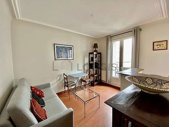Living room furnished with 1 sofabed(s) of 140cm, hi-fi stereo, 1 chair(s)