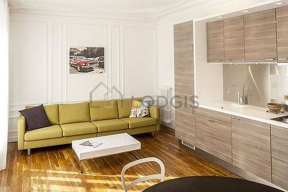 Quiet living room furnished with home cinema, tv, hi-fi stereo, 1 chair(s)