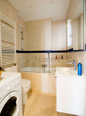 Bathroom equipped with washing machine, shelves