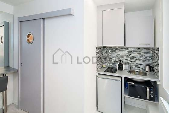 Kitchen equipped with refrigerator, crockery
