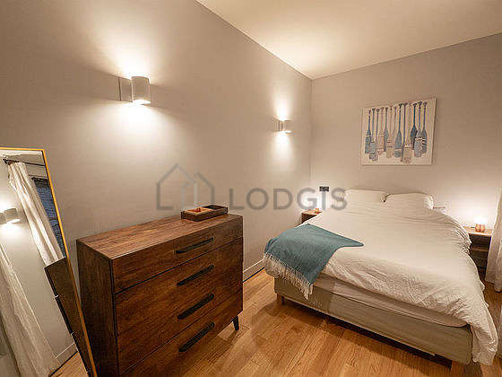 Bedroom equipped with storage space, bedside table