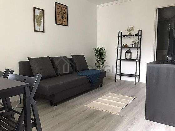 Living room furnished with tv, closet, storage space, cupboard