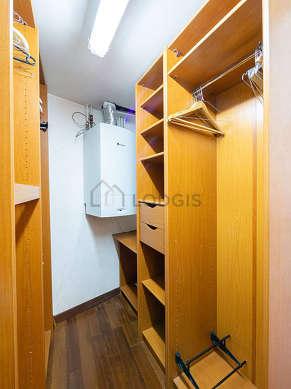Walk-in closet with woodenfloor
