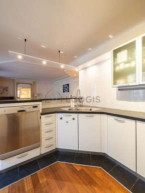 Kitchen where you can have dinner for 4 person(s) equipped with washing machine, refrigerator, crockery