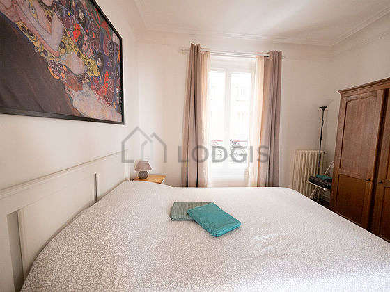 Very bright bedroom equipped with closet, stool