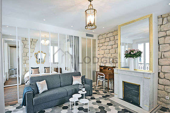 Quiet living room furnished with 1 sofabed(s) of 160cm, air conditioning, tv, 1 chair(s)
