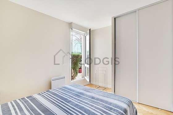 Bedroom with windows facing the garden
