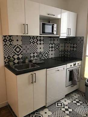 Kitchen of 14m² with tilefloor