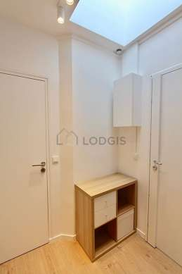 Very beautiful laundry room with woodenfloor and equipped with washing machine, dryer, refrigerator, 1 chair(s)