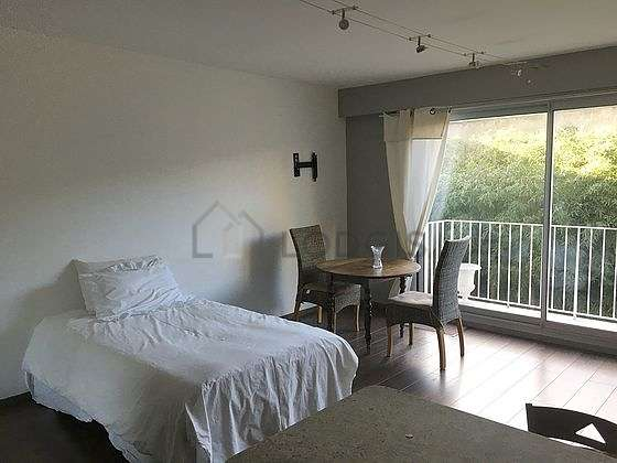 Very quiet living room furnished with 1 bed(s) of 120cm, tv, wardrobe, cupboard