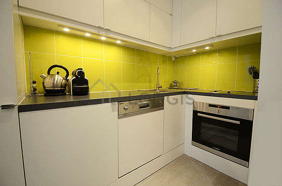 Kitchen equipped with washing machine, dryer, refrigerator, crockery