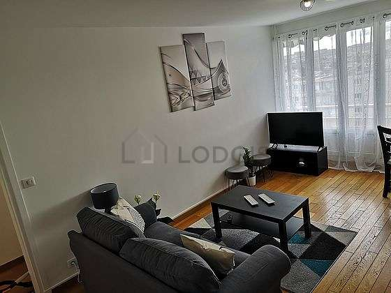 Very quiet living room furnished with tv, closet, cupboard, 1 chair(s)