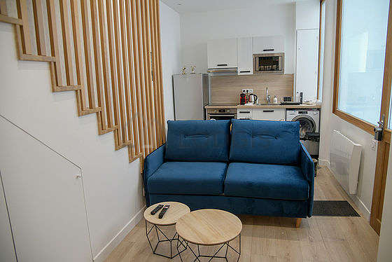 Very quiet living room furnished with tv, wardrobe