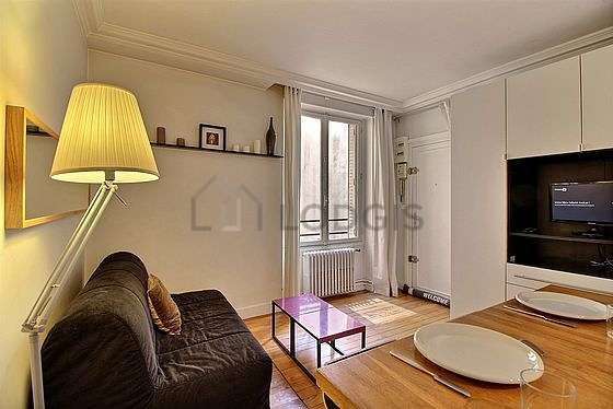 Very quiet living room furnished with 1 sofabed(s) of 120cm, tv, storage space, cupboard