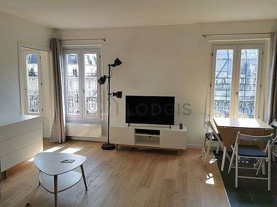 Very quiet living room furnished with tv, closet, storage space, cupboard