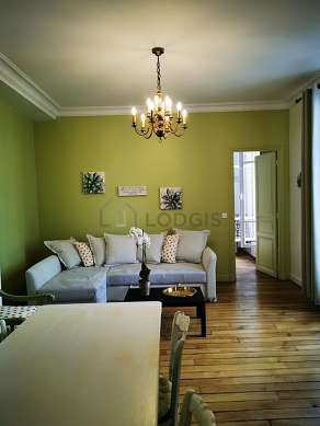 Very quiet living room furnished with 1 sofabed(s) of 160cm, home cinema, tv, fan